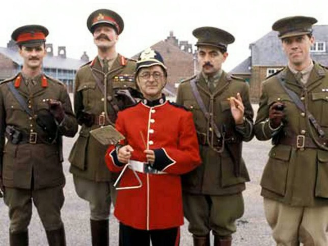 """**EMBARGOED UNTIL 12.01AM ON WED 25 JUNE** Web Grab - Blackadder Goes Forth (1989) (L-R) -Captain Kevin Darling (Tim McInnery), General Melchett (Stephen Fry), Private Baldrick (Tony Robinson), Captain Blackadder (Rowan Atkinson), and Lieutenant George (Hugh Laurie). Captain Blackadder, Lieutenant George and Private Baldrick really did go forth in World War One after it emerged the comedy characters had real-life namesakes.  See NTI story NTIBLACKADDER.  The popular BBC series ran from 1983 until 1989 and ended its run in the trenches with the gang going over the top for """"one last hurrah"""".  Earlier this year, the education secretary Michael Gove criticised the Blackadder series for spreading myths about World War One.  But now it has emerged that the characters - invented by Richard Curtis and Rowan Atkinson - really did exist.  To mark the centenary of the Great War, a specialist military genealogy website has tracked down the real life counterparts of Captain Blackadder and his pals.  Forces War Records delved back through a staggering six million military records to reveal the stories of Captain Robert John Blackadder, Private James Baldrick, Captain John Clive Darling and Lieutenant Athelstan Key Durance George."""