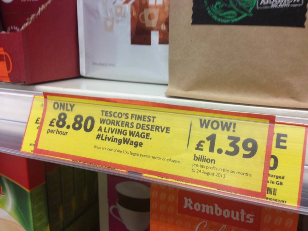 """LIVING wage campaigners are using guerrilla tactics to target Tesco by replacing price tags with labels of their own... ..The labels mimic the supermarket¿s own shelf tabs, but the prices have been replaced by """"£8.80"""" ¿ the living wage hourly rate... ..Product information has also been swapped with a campaign message, which plays on the name given to Tesco¿s top range of goods... ..The labels, put up by campaign group Share Action, read: ¿Tesco¿s Finest workers deserve a living wage #living¿... ..An online petition has been set up by the group ahead of Tesco¿s annual shareholder meeting later this month and has gained nearly 25,000 signatures... n**MANDATORY CREDIT SHARE ACTION/LONDON MEDIA**n©London Media Press Ltdn11a Printing House YardnLondon E2 7PRn0207 613 2548nn *** Local Caption *** ALL MATERIAL MUST BE CREDITED """"LONDON MEDIA"""". 100% SURCHARGE IF NOT CREDITED"""