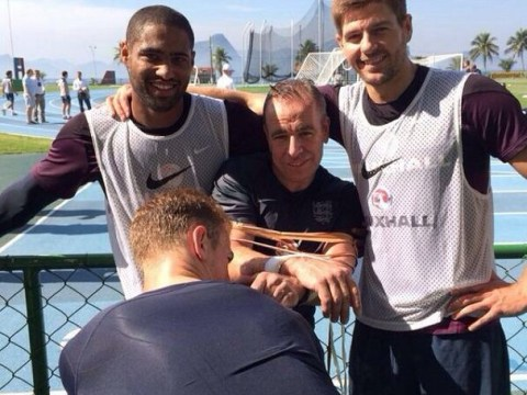 England players chill out before Uruguay clash by dumping masseur in ice bath to celebrate 50th birthday