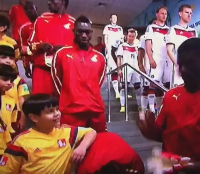 This cheeky mascot took his chance to lean on a Ghana player (Picture: BBC)