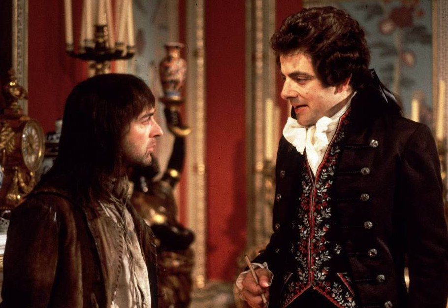Television programmes: 'Blackadder III' Tony Robinson (L) & Rowan Atkinson.  Blackadder the Third. A couple of hundred years on.  Blackadder (Rowan Atkinson) re-emerges as the butler and confidante of George Prince Regent (Hugh Laurie), a well-meaning, dandified dunderhead.  Blackadder s life is full of problems with Samuel Johnson, the Duke of Wellington, Pitt the Younger (aged 13) and the most stupid Baldrick (Tony Robinson) so far.