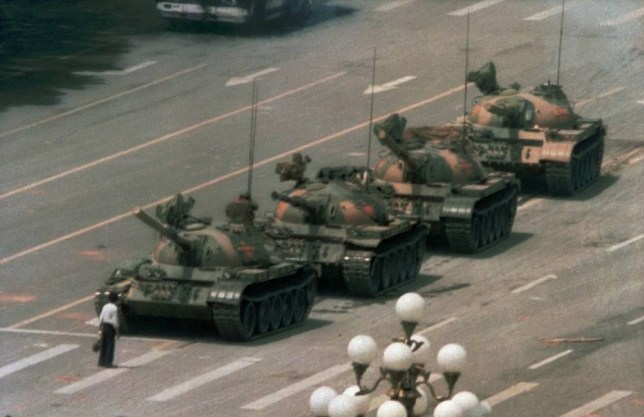 A Chinese man blocks a line of tanks heading east on Beijing's Changan Blvd. after Chinese forces crushed a pro democracy demonstration in Tiananmen Square on June 5, 1989.  The man, calling for an end to the recent violence and bloodshed against pro-democracy demonstrators, was pulled away by bystanders, and the tanks continued on their way.  (AP Photo/Jeff Widener)...I