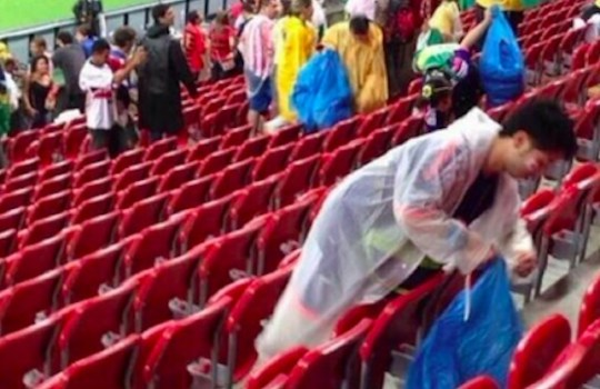 Japan fans cleared up their litter after losing to the Ivory Coast (Picture: Twitter)