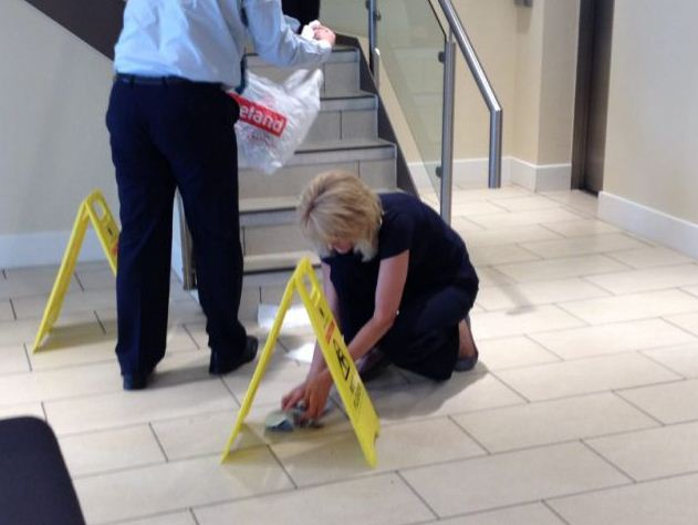 Staff clean up the dirty protest mess (Picture: SWNS)
