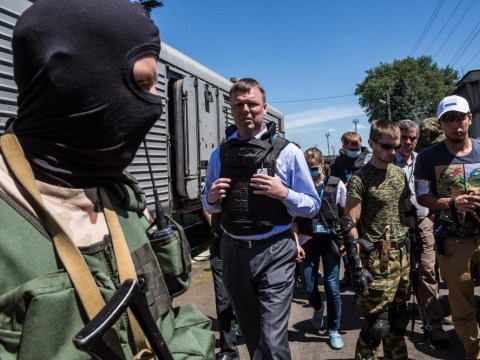 Flight MH17: Refrigerated train carrying the victims' remains is finally on the move