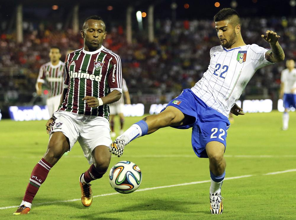 Italy's national soccer team plauyer Lorenzo Insigne, right, challenges for the ball with Fluminense defender Chiquinho during a World Cup warmup soccer match between Italy and Fluminense at the Cidadania stadium, in Volta Redonda, Brazil, Sunday, June 8, 2014. Italy plays in group D of the 2014 soccer World Cup. (AP Photo/Antonio Calanni) AP Photo/Antonio Calanni