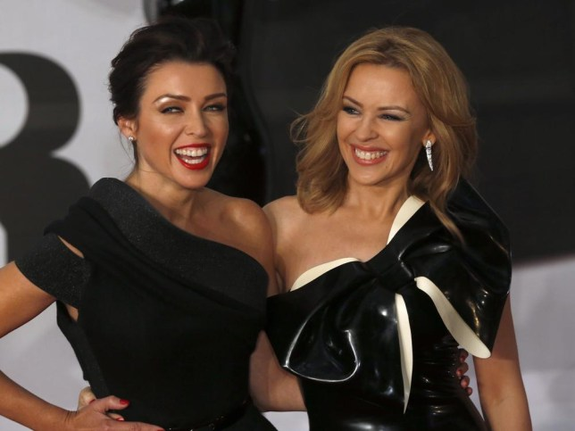 Singers and sisters Dannii (L) and Kylie Minogue arrive for the BRIT Awards, celebrating British pop music, at the O2 Arena in London February 19, 2014. REUTERS/Luke MacGregor (BRITAIN - Tags: ENTERTAINMENT) (BRIT-ARRIVALS) Luke Macgregor/Reuters