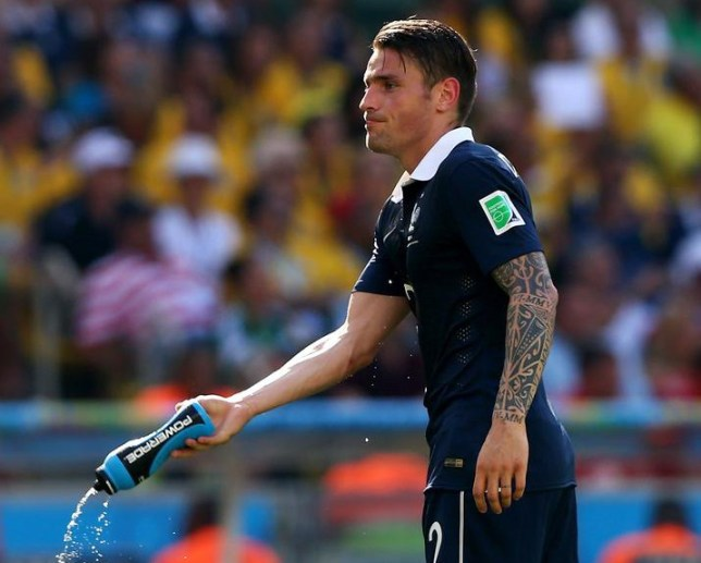 RIO DE JANEIRO, BRAZIL - JULY 04: Mathieu Debuchy of France throws a water bottle during the 2014 FIFA World Cup Brazil Quarter Final match between France and Germany at Maracana on July 4, 2014 in Rio de Janeiro, Brazil. Jamie Squire/Getty Images
