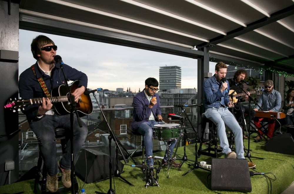Kaiser Chiefs perform an acoustic set on a central London rooftop, for an XFM 'Born to be Chilled' session with Carlsberg Citrus  Must credit: Kaiser Chiefs Xfm Born to be Chilled Session with Carlsberg Citrus. Credit: John Phillips NO FEE