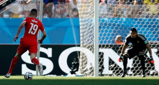 Switzerland's Josip Drmic, left, bears down on goal during the World Cup round of 16 soccer match between Argentina and Switzerland at the Itaquerao Stadium in Sao Paulo, Brazil, Tuesday, July 1, 2014. (AP Photo/Frank Augstein)
