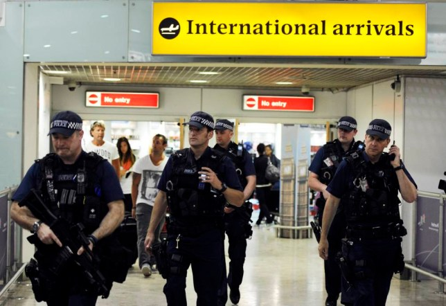 epa04296341 (FILE) A file picture dated 23 July 2012 shows British police on patrol at Heathrow airport during the arrivals of Olympic athletes in London, Britain. US security officials are seeking to bolster security at airports abroad with flights to the United States amid new worries about potential bomb plots, Homeland Security Secretary Jeh Johnson said 02 July 2014.  EPA/FACUNDO ARRIZABALAGA