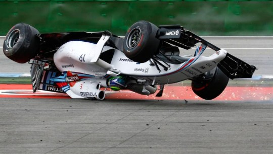 Williams Formula One driver Felipe Massa of Brazil crashes with his car in the first corner after the start of the German F1 Grand Prix at the Hockenheim racing circuit, July 20, 2014.    REUTERS/Kai Pfaffenbach (GERMANY - Tags: SPORT MOTORSPORT F1 TPX IMAGES OF THE DAY)