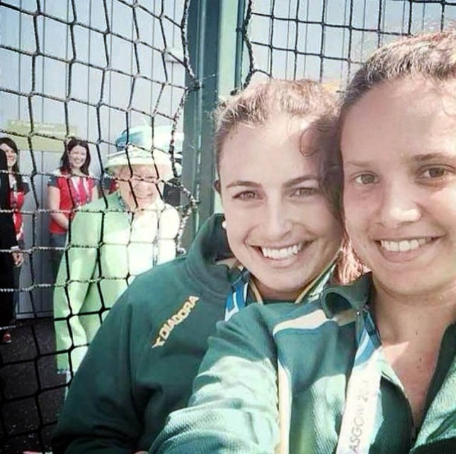 THE QUEEN has photobombed her first ever picture at the Commonwealth Games. Her Majesty is in Glasgow for the Games when she appeared to smile and peak in behind a group of Australian hockey players. The picture was posted to Twitter by Jayde Taylor, 29, (left) who had been taking part in her first match of the competition. Writing alongside the picture Ms Taylor said: ìAhhh The Queen photo-bombed our selfie!! #royalty #sheevensmiled #amazing #Glasgow2014î