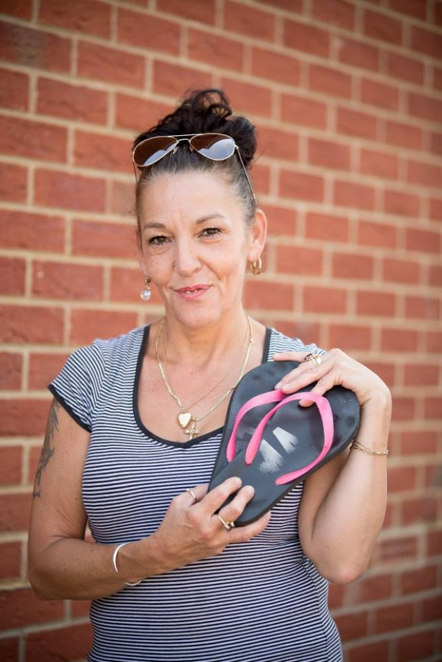 Jennifer Lyon, 49, who was struck by lightning inside  her home in Chippenham, Wiltshire, but was saved because she was wearing her flipflops.  July 24 2014.   See SWNS story SWFLIP; A nurse struck by lightning had a miracle escape after she was saved - by her rubber FLIP FLOPS. Lucky Jennifer Lyons, 49, was on the phone to a friend when her TV satellite dish was hit by the massive bolt. The energy from the 300,000 volt strike was then attracted to the microwaves emitted from her mobile. She was zapped in the head by the lightning but the care home nurse had a miracle escape - because of her favourite pair of flip flops.