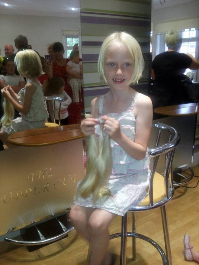 Collect picture of Charlie Tillotson after her hair cut holding the hair that was chopped off. See SWNS story SWHAIR; A real-life Rapunzel has cut off 2ft of her flowing blonde locks - so a young cancer sufferer can feel like a princess. Selfless Charlie Tillotson, six, brought her dad Steve to tears when she told him she wanted to chop off her hair to help girls with cancer after watching a TV programme. The schoolgirl - who had never even had a trim before - had her glowing mane lopped off last week and it is being turned into a wig by charity The Little Princess Trust. A wig with a similar amount of natural hair would cost around £5,000 to buy.Her family and friends were so impressed by her generous act they have also helped her raise more than £1,300 for Children with Cancer UK.