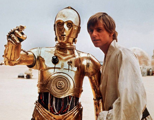 "Mark Hamill as Luke Skywalker (r) and golden Android C3PO (Anthony Daniels) in ""Star Wars"""