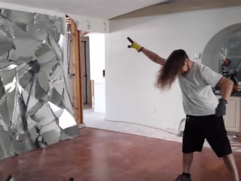 Headbanging builder whips his hair back and forth
