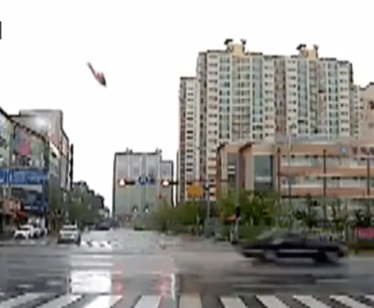 The helicopter, moments before hitting the black of flats (Picture: Youtube)