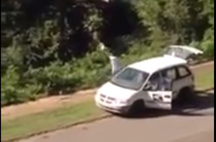 Lazy postal worker caught on camera throwing packages into a ravine
