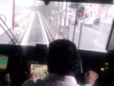 Man takes multi-tasking to the next level by playing FarmVille while driving a TRAIN in Mexico