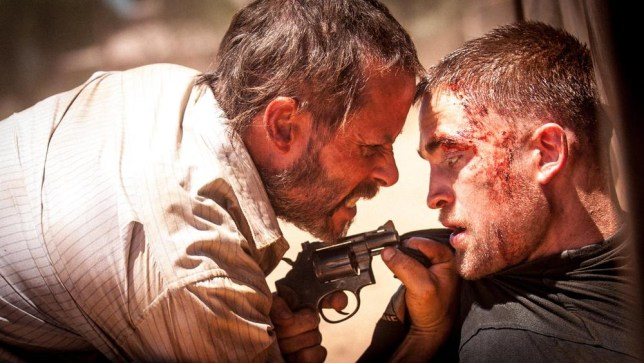 "This image released by Cannes Film Festival shows Guy Pearce, left, and Robert Pattinson in a scene from ""The Rover."" (AP Photo/Cannes Film Festival) AP Photo/Cannes Film Festival"