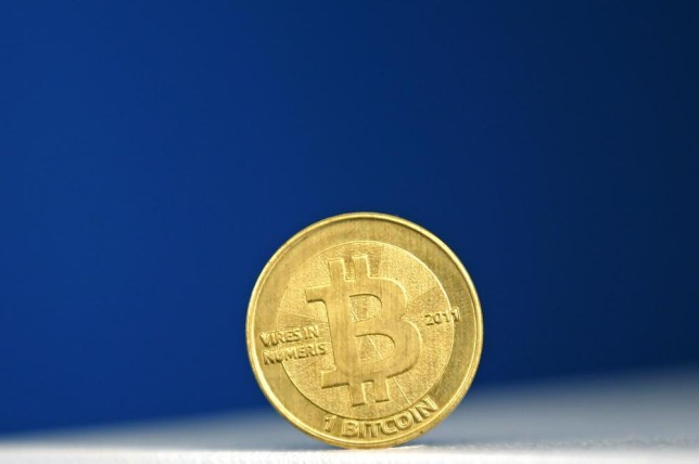 A Bitcoin (virtual currency) coin is seen in an illustration picture taken at La Maison du Bitcoin in Paris July 11, 2014. French police dismantled an illegal Bitcoin exchange and seized 388 virtual currency units worth some 200,000 euros ($272,800) in the first such operation in Europe a public prosecutor said on Monday. REUTERS/Benoit Tessier (FRANCE - Tags: BUSINESS) Benoit Tessier/Reuters