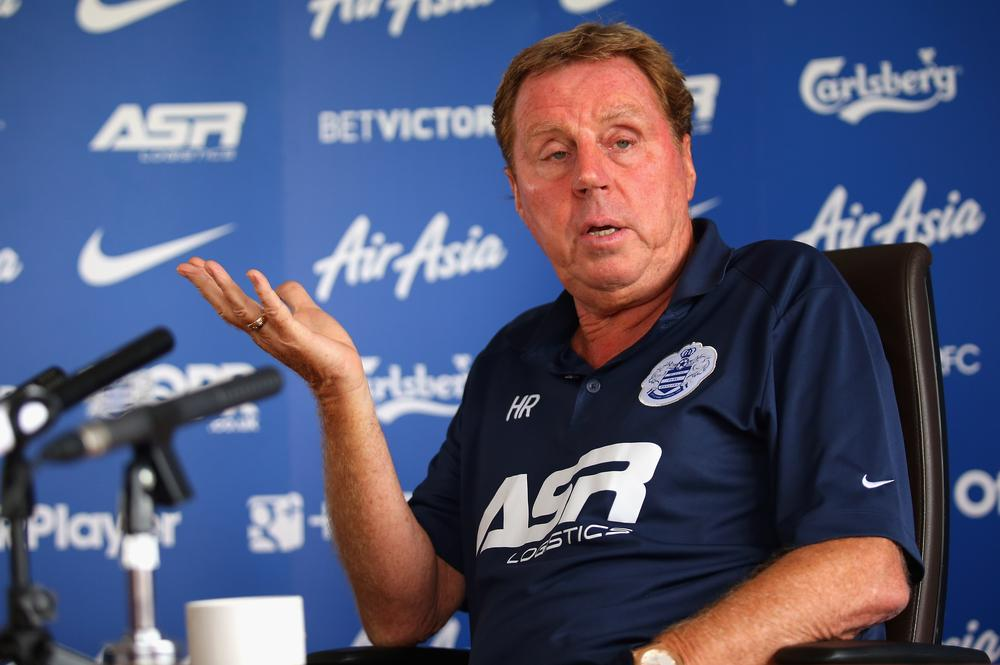 QPR boss Harry Redknapp prepares the car window for another busy transfer deadline day