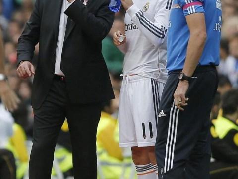 Sneaky Carlo Ancelotti photobombs Gareth Bale selfie during Real Madrid training