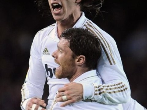 Xabi Alonso and Sergio Ramos show off their American football skills during training session in USA