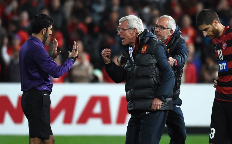 World Cup winning manager Marcello Lippi loses the plot and invades the pitch
