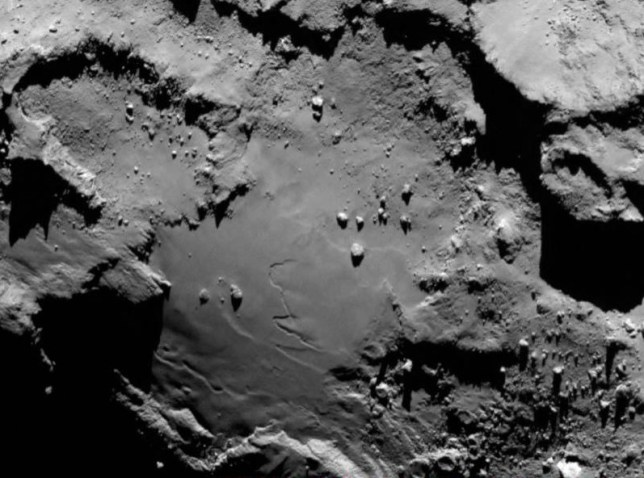 IN SPACE - AUGUST 3:  In this handout from the European Space Agency (ESA), the comet Comet 67P/Churyumov-Gerasimenko is seen in a detail photo taken by the Rosetta spacecraft with the OSIRIS narrow-angle camera August 3, 2014 in space. ESA's Rosetta spacecraft became the first to rendezvous with a comet and will follow it on the journey around the sun.   (Photo by ESA/Rosetta/MPS for OSIRIS Team MPS/UPD/LAM/IAA/SSO/INTA/UPM/DASP/IDA via Getty Images)