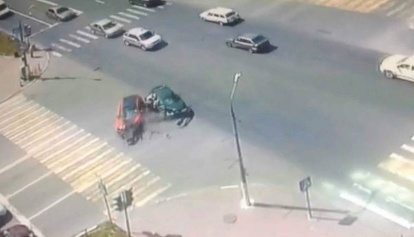 """Pic shows: The accident scene. Astonished police have criticised a selfish mum who after causing a car crash that sent her four-year-old twin sons flying out of the car and over the road was only worried about the punishment she would get. Rescuers were amazed to find that the mum Yulia Krapova, 36, her 38-year-old husband Igor, and sons Nikita and Sasha had survived with barely a scratch. Russian police say Yulia had turned left across a stream of traffic without checking what was coming towards her. Her car was hit so hard by another vehicle that her husband and their twins were hurled out of the vehicle. CCTV footage of the crash in the western Russian city of Orekhovo-Zuyevo shows that the crash was so hard that both cars disintegrated. But when police asked her what had happened, she did not ask about her family and only said: """"What is going to happen to me because of this? Will I go to jail?"""" One officer said: """"It shows what was most important to her at time. It was not the reply that officers had expected."""" Police released shocking CCTV footage of the crash as a warning to other motorists. A local police spokesman said: """"Both children were in children's seat but they were not belted in properly, so there are passenger endangerment issues for prosecutors to consider."""" The other driver - Ivan Zhuganov, 46 - also escaped serious injury. (ends)"""