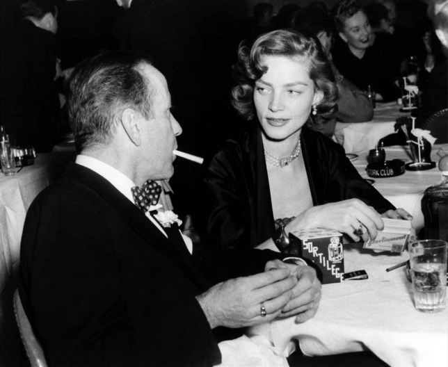 FILE - In this Feb. 1950 file photo actor Humphrey Bogart, left, and his wife, actress Lauren Bacall, appear at the Stork Club in New York. Bacall, the sultry-voiced actress and Humphrey Bogartís partner off and on the screen, died Tuesday, Aug. 12, 2014 in New York. She was 89. (AP Photo, File)