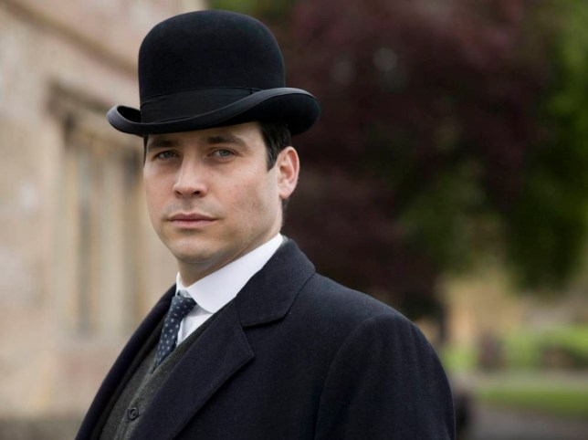 From Carnival Film & Television LtdnnDownton Abbey Series 5 on ITVnnPictured: ROB JAMES-COLLIER as Thomas.nnThe fifth series, set in 1924, sees the return of our much loved characters in the sumptuous setting of Downton Abbey. As they face new challenges, the Crawley family and the servants who work for them remain inseparably interlinked.nnPhotographer: Nick Briggsnn© Carnival Film & Television Ltd