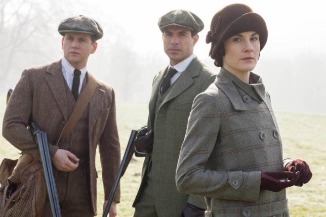 From Carnival Film & Television LtdnnDownton Abbey Series 5 on ITVnnPictured: ALLEN LEECH as Tom Branson, TOM CULLEN as Gillingham and MICHELLE DOCKERY as Lady Mary Crawley. nnThe fifth series, set in 1924, sees the return of our much loved characters in the sumptuous setting of Downton Abbey. As they face new challenges, the Crawley family and the servants who work for them remain inseparably interlinked.nnPhotographer: Nick Briggsnn© Carnival Film & Television Ltdn