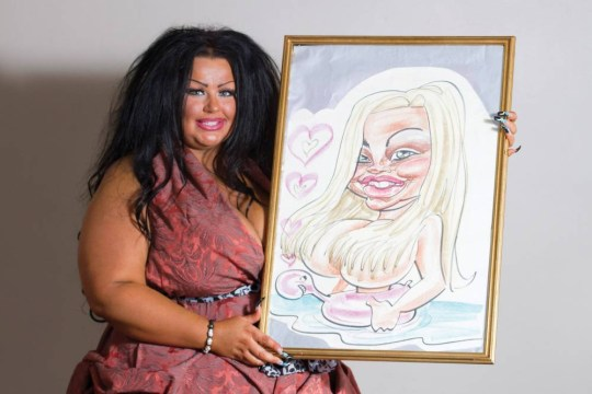 Krystina Butel, 30, from Wakefield, Yorkshire, with her caricature that she had done of herself when she was 15-years-old on holiday in Ibiza. Krystina then spent 100k worth of plastic surgery to look like the cartoon drawing, Thursday 31st July, 2014.  Ö PIC BY NEWS DOG MEDIA .. +44 (0)121 246 1932