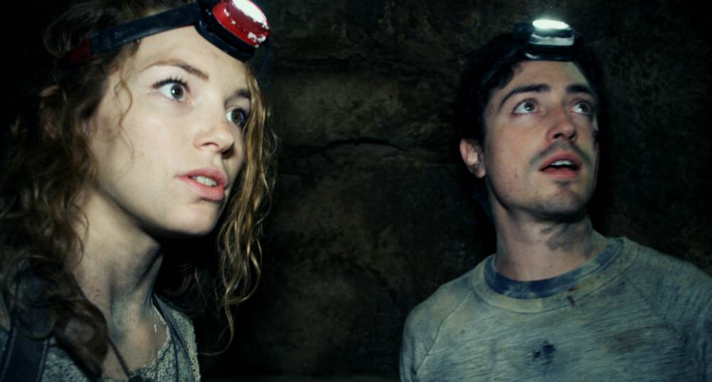 """This image released by Universal Pictures shows Perdita Weeks, left, and Ben Feldman in a scene from the film, """"As Above, So Below."""" (AP Photo/Universal Pictures)"""