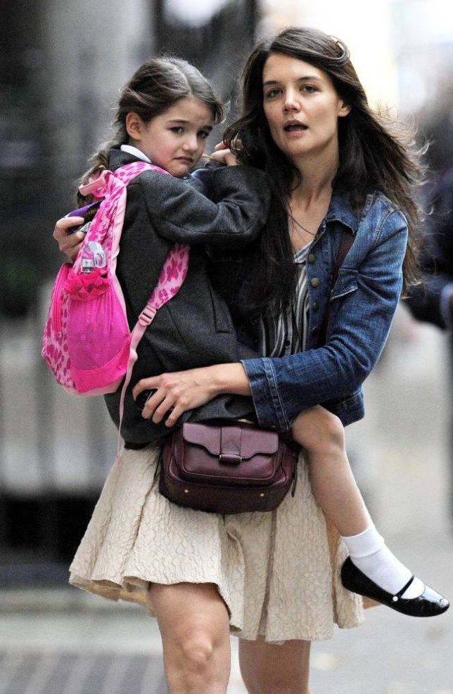 Mandatory Credit: Photo by Startraks Photo/REX (1967812ab).. Katie Holmes with daughter Suri Cruise.. Katie Holmes out and about, New York, America - 12 Nov 2012.. Katie Holmes picks her daughter Suri Cruise up from School. Suri starts to cry because of the Paparazzi...