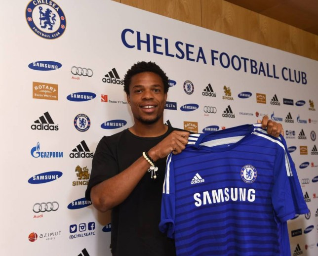 Chelsea FC via Press Association Images MINIMUM FEE 40GBP PER IMAGE - CONTACT PRESS ASSOCIATION IMAGES FOR FURTHER INFORMATION. Chelsea's new signing Loic Remy holds up his new shirt at the Cobham Training Ground on 31st August 2014 in Cobham, England.