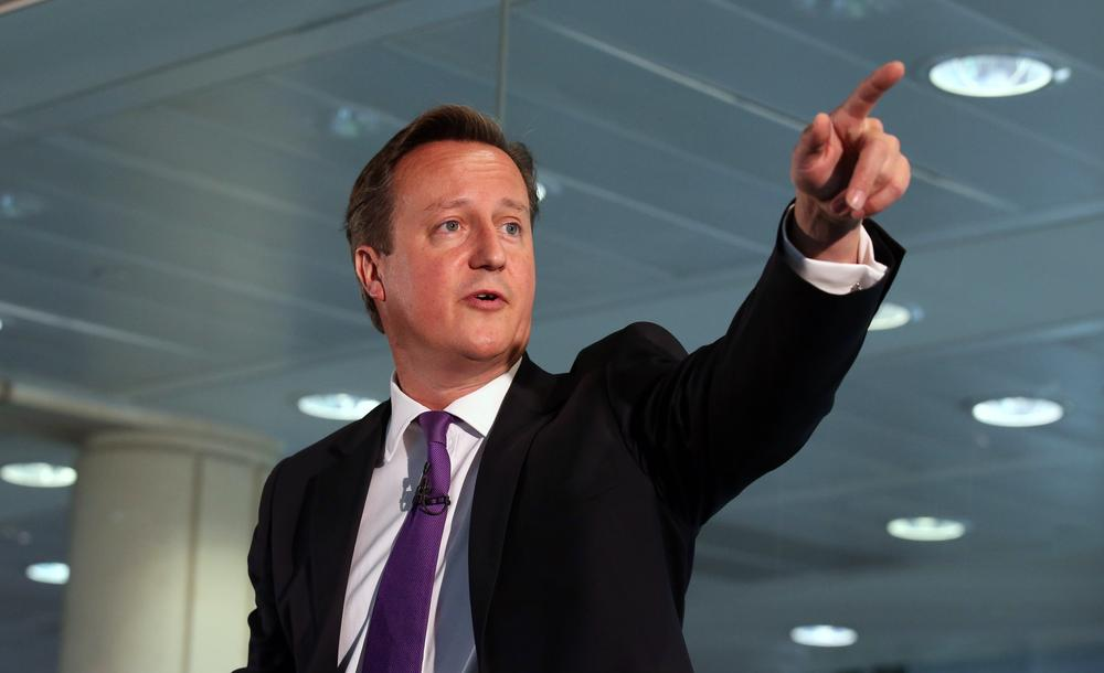 """Britain's Prime Minister, David Cameron, points whilst speaking during a visit to a financial office in Edinburgh, Wednesday Sept. 10, 2014. Cameron made an impassioned plea to keep Scotland part of the union, saying he would be """"heartbroken"""" if the United Kingdom was torn apart. (AP Photo/PA, Andrew Milligan) UNITED KINGDOM OUT NO SALES NO ARCHIVE"""