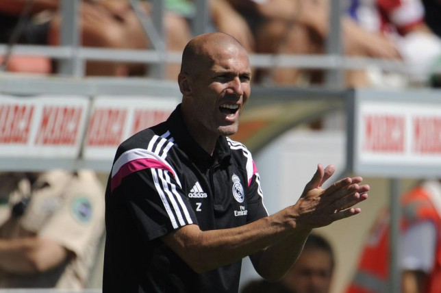 Former French football star and new coach of Real Madrid Castilla Zinedine Zidane reacts during the Spanish League B football match Real Madrid Castilla vs Atletico de Madrid at the Cerro del Espino stadium in Majadahonda, near Madrid on August 24, 2014. AFP PHOTO/ PEDRO ARMESTRE PEDRO ARMESTRE/AFP/Getty Images