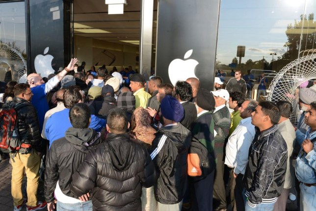 You won't be seeing queues like this in front of Apple Stores in China for some time (Picture: AP)