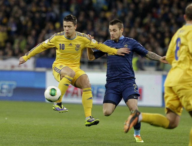France's Mathieu Debuchy, right, challenges for the ball with Yevhen Konoplyanka of Ukraine during their 2014 World Cup qualifying playoff first leg soccer match at the Olympiyskiy national stadium in Kiev, Ukraine, Friday, Nov. 15, 2013.(AP Photo/Sergei Chuzavkov) AP Photo/Sergei Chuzavkov