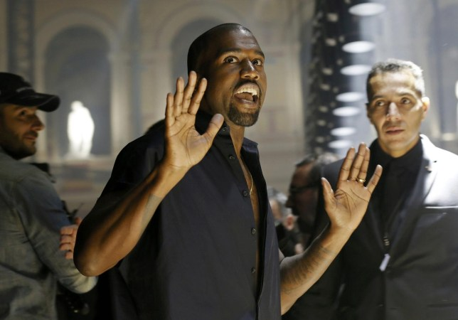 Rapper Kanye West reacts as he arrives to attend the Israeli-American designer Alber Elbaz Spring/Summer 2015 women's ready-to-wear collection for fashion house Lanvin during Paris Fashion Week September 25, 2014. REUTERS/Gonzalo Fuentes (FRANCE - Tags: FASHION) Gonzalo Fuentes/Reuters