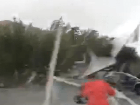 This is why you should never go out in a hurricane: Smashed window blasts woman in car park