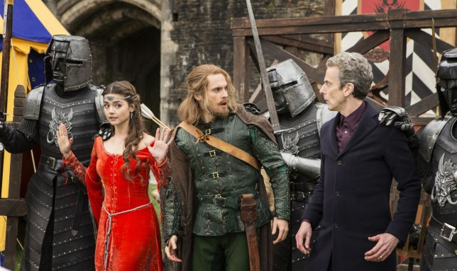WARNING: Embargoed for publication until: 02/09/2014 - Programme Name: Doctor Who - TX: 06/09/2014 - Episode: n/a (No. 3) - Picture Shows: L - R Robin Hood (TOM RILEY), Clara (JENNA COLEMAN), The Doctor (PETER CAPALDI) - (C) BBC - Photographer: Adrian Rogers