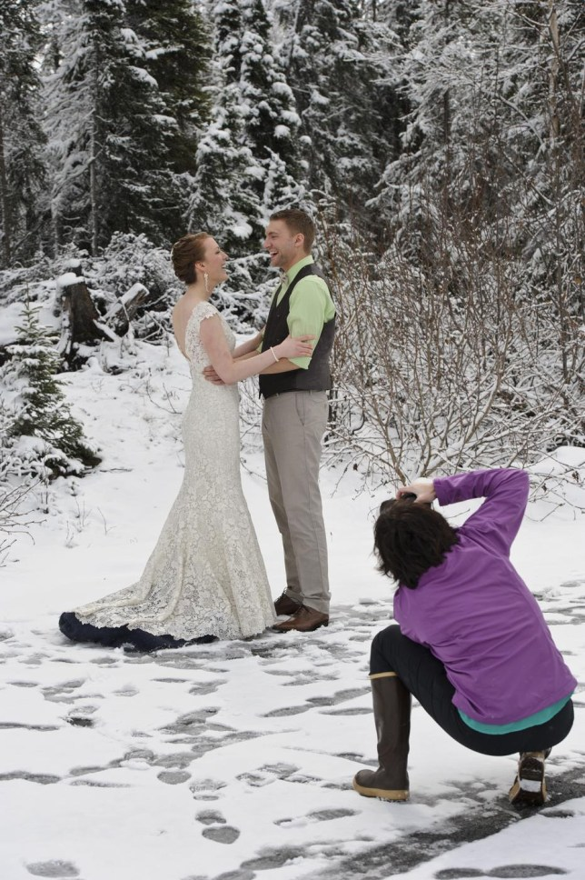 Mary Anne Feeney and Jonathan Brady have portraits made by Rhae Anne Etheredge, right, a few hours before their wedding ceremony on Saturday, May 18, 2013, in Anchorage, Alaska. Snow fell steadily in the Anchorage area on Friday evening and Saturday morning, setting new daily records for snowfall on both days.