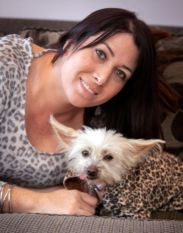 Luisa reunited with her dog, Lola (Picture: SWNS)