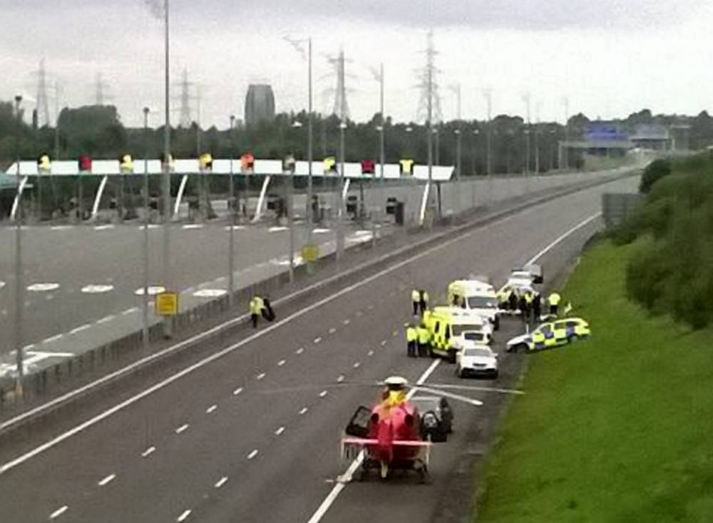 Two police officers have been taken to hospital after a car they were chasing ploughed into them at 90mph on a motorway. See News Team story NTICRASH; Traffic cops began tracking the MG ZR when it was seen being driven erratically on the M6 Toll through Staffordshire at around 10am yesterday (Sat). Central Motorway Police Group officers set up a rolling road block between juntions T8 and T6 to try and bring vehicle to a halt. But as police attempted to stop the car for a second time it smashed into a marked police BMW.