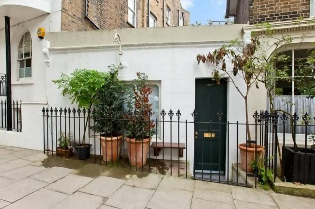 """This house thought to be one of the smallest in the world has been put on the market -- costing potential buyers more than quarter of a million pounds. See SWNS story SWHOUSE: The pint-sized property is described by estate agents as """"unique"""" and it boasts just one room. The house is made up of just 188 sq ft of living space but incorporates a kitchen, living area, bathroom and bedroom into the space. Residents in the home will be forced to walk across the kitchen worktop before balancing on narrow steps, to make it to the 2.29m x 1.73m airborne """"bedroom""""."""